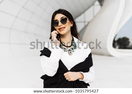 happy woman in a business suit speaks by phone