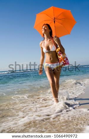 happy woman in bikini walking...