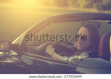 Happy woman in cabriolet car #277033049