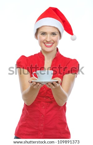 Happy woman in Christmas hat holding cup of hot beverage