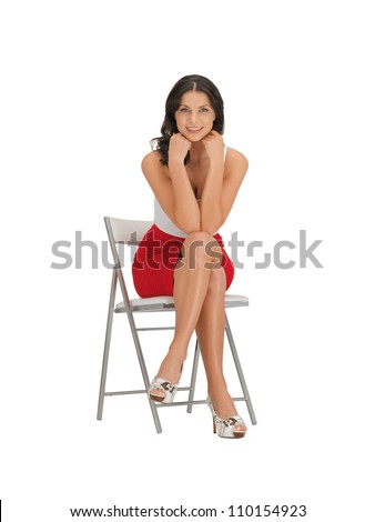 happy woman in dress on a chair