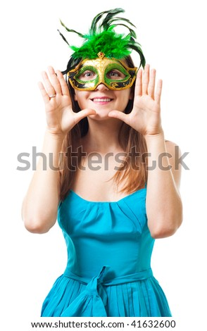 Happy woman in green theater mask with her hands close  to her face