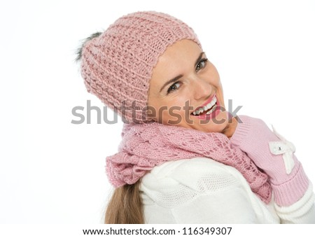 Happy woman in knit scarf, hat and mittens