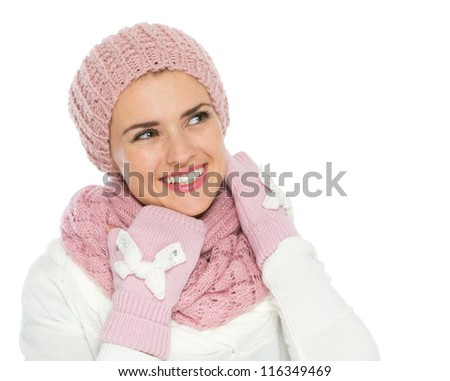 Happy woman in knit winter clothing looking on copy space