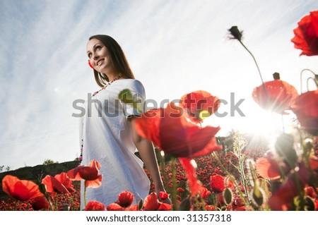 Happy woman in poppy field