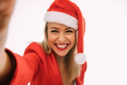 happy woman in red and white christmas hat do selfie with smile