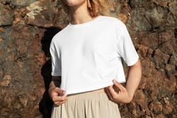 Happy woman in white crop top outdoor photoshoot