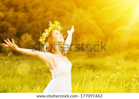 happy woman in wreath outdoors summer enjoying life opening hands