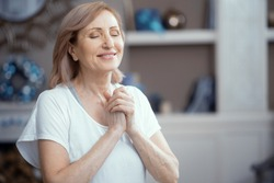 Happy Woman Is Pressing Her Arms To The Chest. Satisfied Woman With Closed Eyes Smiles And Presses Hands To The Chest. Portrait. Woman In Prayer Pose.