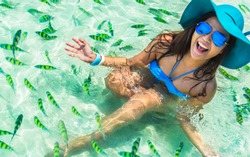 Happy woman joy fun on clear blue sea water with fishs in Krabi beach Amazing adventure travel Phuket Thailand vacation trips Tourism beautiful destinations place Asia Girl traveler on summer holidays