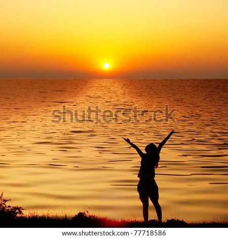 Happy woman jump and sunset silhouette in Lake