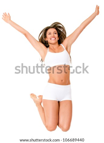 Happy woman jumping in her underwear - isolated over a white background