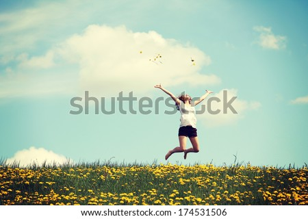 Happy woman jumping on blossom meadow. Beautiful day on field. #174531506