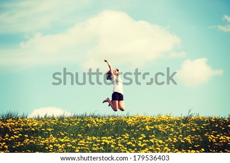 happy woman jumping on blossom...