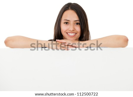 Happy woman leaning on a banner - isolated over a white background - stock photo