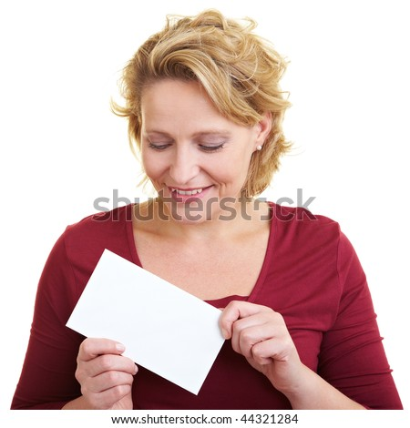 Happy woman looking at a white letter in her hand