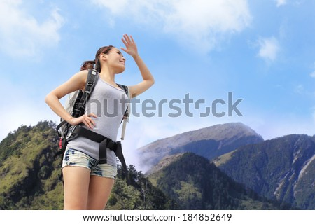 happy woman mountain hiker with backpack and looking to sky on the top of mountains. asian #184852649