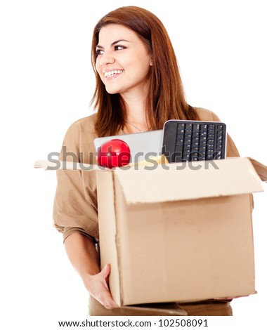Happy woman moving house and packing - isolated over white
