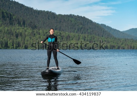 Happy woman on paddle board