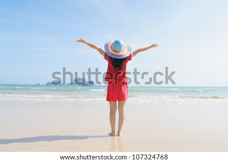 Happy woman on the beach in Krabi Thailand