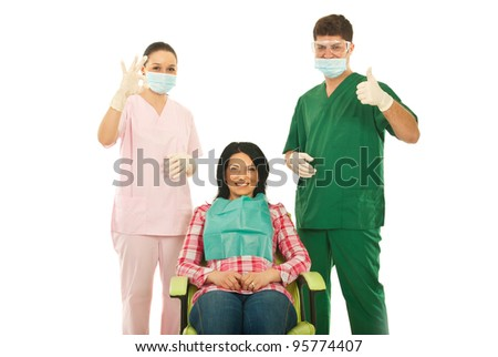 Happy woman patient sitting on chair at dentist and the doctors giving thumbs up isolated on white background