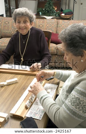 happy woman playing mah-jong with friends attractive smiling