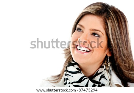 Happy woman portrait smiling and looking beautiful - isolated over a white background