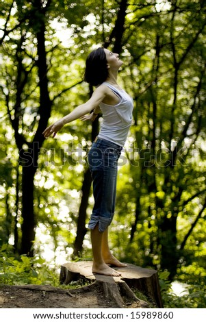 happy woman preparing to fly in a forest