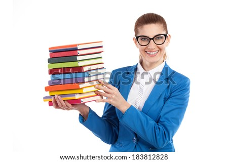 Happy woman presenting stack of books. Smiling elegance teacher in black glasses holding stack of books. Waist up studio shot isolated on white.