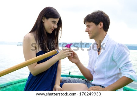Happy woman receiving romantic present from handsome man