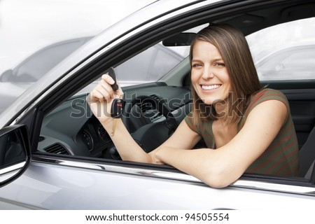 Happy Woman Renting or Buying a Car - stock photo
