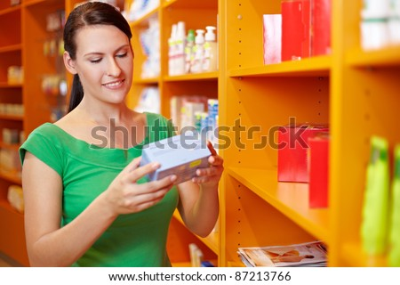 Happy woman shopping for products in a drugstore