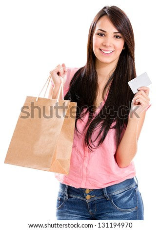 Happy woman shopping with a credit card - isolated over white