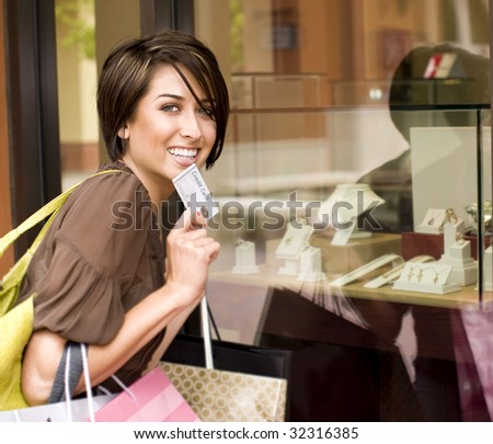 Happy woman shopping with her credit card - stock photo