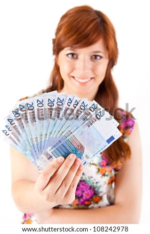 Happy woman showing Euros currency notes - stock photo