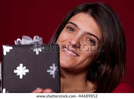 Happy woman showing her christmas present