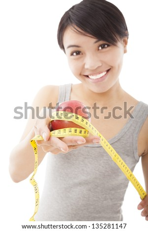 happy woman showing scales and green apple for healthy concept