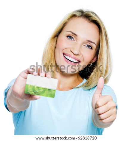 happy woman showing thumbs-up with credit card on white bacground