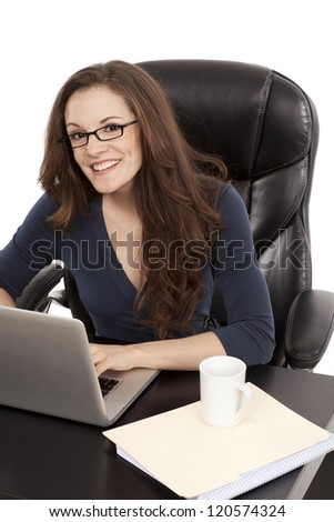 Happy woman sits at her desk