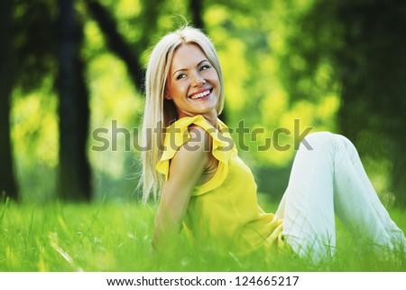 happy woman sitting on grass