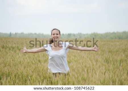 Happy woman smiles in a meadow