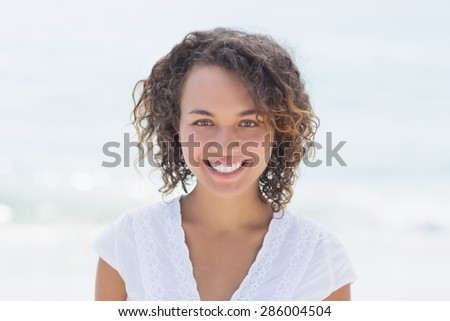 happy woman smiling at the beach