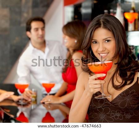 happy woman smiling in a bar or a nightclub