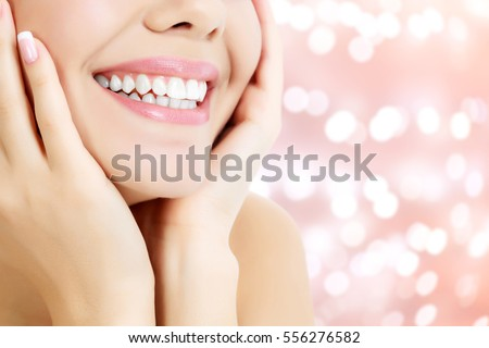 Happy woman smiling on an abstract background with blurred lights