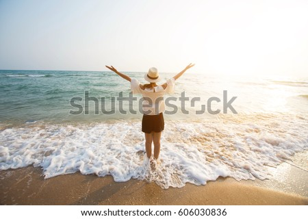 happy woman stand on sand of...
