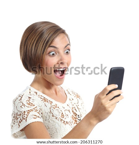 Happy woman surprised looking her smart phone isolated on a white background