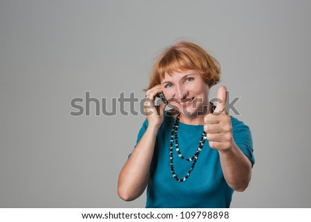 Happy woman Talking On Mobile Phone with thumb up