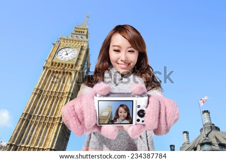 Happy woman tourist travel in london and photo selfie by camera with Big Ben in United Kingdom, uk