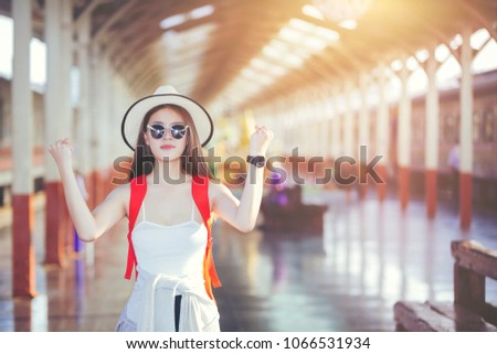 Happy woman tourists in the train station, Tourist traveler sunlight in trip in thailand country -  backpack travel concept, Travel concept #1066531934