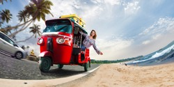 Happy woman travel by traditional srilankan transport, road near beautiful sea and plam